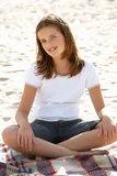 Portrait teenage girl cross legged sitting Royalty Free Stock Photos