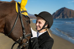 Portrait of teenage girl with a favorite horse Stock Images