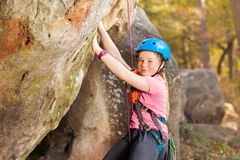 Young mountaineer training rock climbing outdoors royalty free stock image