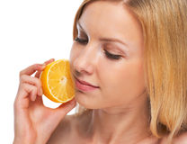 Portrait of teenage girl holding lemon Stock Photography