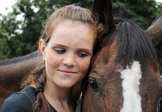 Portrait of teenage girl and horse Stock Photos