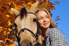 Portrait of teenage girl and horse Royalty Free Stock Images
