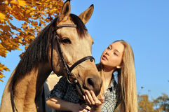 Portrait of teenage girl and horse Royalty Free Stock Photos