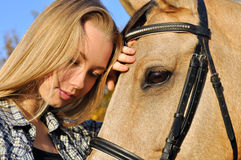 Portrait of teenage girl and horse Stock Images