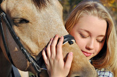 Portrait of teenage girl and horse Stock Image