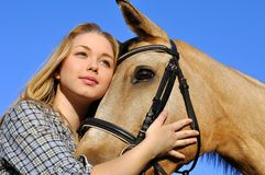 Portrait of teenage girl and horse royalty free stock photo