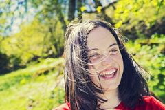 Portrait of a teenage girl laughing. Portrait of a happyl teenage girl laughing in the park Stock Image