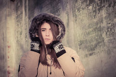 Portrait of a teenage girl outdoor wearing winter coat Stock Photos