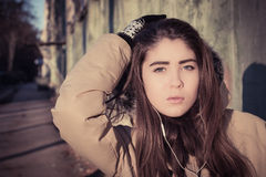 Portrait of a teenage girl outdoor wearing winter coat Royalty Free Stock Photo