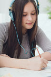 Portrait of teenage girl painter in headphones stock images