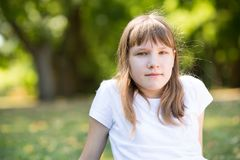 Teenage girl in the park royalty free stock photos