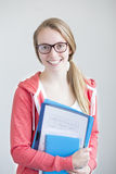Portrait of teenage girl with school work Royalty Free Stock Photos