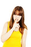 Portrait of teenage girl with silence sign Royalty Free Stock Photos