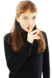Portrait of teenage girl with silence sign Stock Image