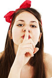 Portrait of teenage girl with silence sign Stock Photo