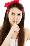 Portrait of teenage girl with silence sign royalty free stock image
