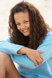 Portrait teenage girl sitting outdoors Stock Images