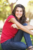 Portrait Of Teenage Girl Sitting In Park Royalty Free Stock Photo