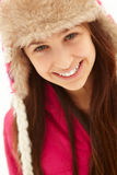 Portrait Of Teenage Girl In Snow Wearing Fur Hat Royalty Free Stock Photography