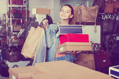 Portrait of teenage girl standing with bags in store with bags Stock Images