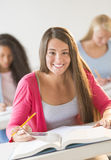Portrait Of Teenage Girl Studying In Classroom Stock Photography