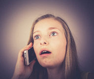 Portrait teenage girl telephoned outraged, grain effect Royalty Free Stock Image