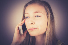 Portrait teenage girl telephoned outraged, grain effect Royalty Free Stock Photos