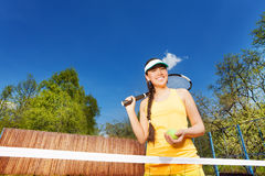 Portrait of teenage girl on tennis court outdoor Royalty Free Stock Images