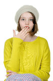 Portrait of a teenage girl who covers her mouth with her palm on. Portrait of a teenage girl on a white background Stock Photos
