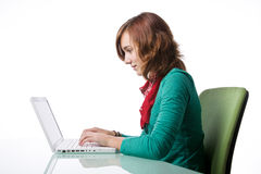 Portrait of a teenage girl working at her computer Royalty Free Stock Photo