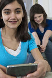 Portrait of a teenage girlfriends sending emails Stock Photos