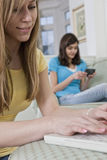 Portrait of a teenage girlfriends sending emails Royalty Free Stock Photo
