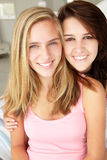 Portrait of teenage girls. Two teenage girls togehter smiling and laughing at camera Royalty Free Stock Images