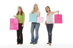 Portrait Of Teenage Girls Holding Shopping Bags Royalty Free Stock Photography