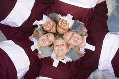 Portrait of teenage girls hugging in sports uniforms Royalty Free Stock Photo
