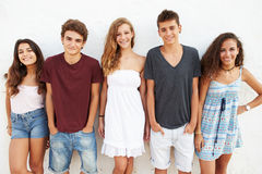 Portrait Of Teenage Group Leaning Against Wall Royalty Free Stock Photos