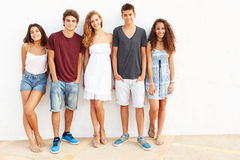 Portrait Of Teenage Group Leaning Against Wall Royalty Free Stock Image