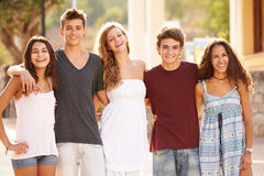 Portrait Of Teenage Group Walking Along Street Royalty Free Stock Images