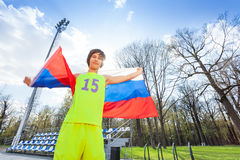 Portrait of teenage runner waving Russian flag Royalty Free Stock Photography