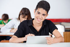 Portrait Of Teenage Schoolboy Using Digital Tablet stock photos