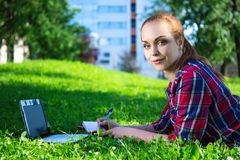 Portrait of teenage student or school girl in park with laptop Royalty Free Stock Photography