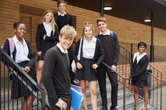 Portrait Of Teenage Students In Uniform Outside School Building stock photos