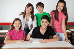 Portrait Of Teenage Students Using Tablet At Desk Stock Images