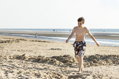 Portrait of teenage is walking on sand Stock Images