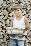 Portrait of teenage woodcutter at firewood Royalty Free Stock Images
