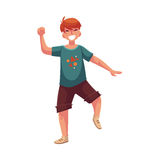Portrait of teenaged red haired boy in shorts dancing Royalty Free Stock Image