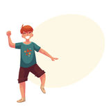 Portrait of teenaged red haired boy in shorts dancing Royalty Free Stock Photo