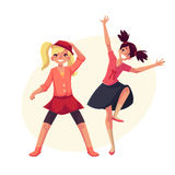 Portrait of teenaged two girls in pink clothes dancing Royalty Free Stock Photography