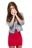 Portrait of a teenager with allergies. Young woman has allergy and blowing her nose Royalty Free Stock Image