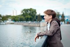Portrait of teenager on background of river Royalty Free Stock Image